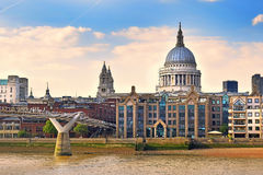 Millennium Bridge, St Pauls Cathedral and embankment of the River Thames, London Stock Image