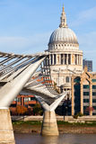 Millennium Bridge with St Pauls Cathedral. St Paul's Cathedral with Millennium Bridge in the foreground Royalty Free Stock Photos