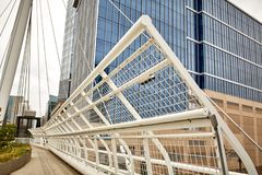 Millennium Bridge at Commons Park in Denver, Colorado. Millennium Bridge structure at the Riverfront Park neighborhood of Denver. Commons Park royalty free stock images