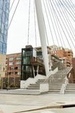 Millennium Bridge at Commons Park in Denver, Colorado. Millennium Bridge structure at the Riverfront Park neighborhood of Denver. Commons Park stock photo