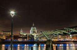 Millennium Bridge to St Pauls Cathedral. St Pauls cathedral and the Millennium bridge at night from Bankside. London, UK Stock Photo