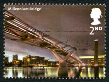 Millennium Bridge UK Postage Stamp. GREAT BRITAIN - CIRCA 2002: A used postage stamp from the UK, depicting an image of the Millennium Bridge spanning over the stock photography
