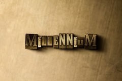 MILLENNIUM - close-up of grungy vintage typeset word on metal backdrop. Royalty free stock illustration.  Can be used for online banner ads and direct mail Royalty Free Stock Image