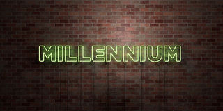 MILLENNIUM - fluorescent Neon tube Sign on brickwork - Front view - 3D rendered royalty free stock picture. Can be used for online banner ads and direct Royalty Free Stock Images