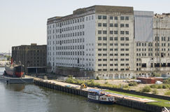 Millennium Mills, Royal Victoria Docks. The abandoned buildings of Millennium Mills.  Former flour mills, built in the early 20th century.  Royal Victoria Dock Royalty Free Stock Photo
