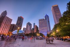 Millennium Park, Chicago. Tourists visit Cloud Gate in Millennium Park stock photos