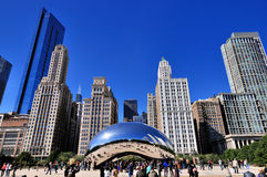 Millennium park and city buildings, Chicago. Famous Chicago Millennium Park and Slivery Bean sculpture, Photo taken in October 6th, 2014 Royalty Free Stock Image