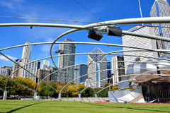 Millennium park, Pritzker Pavilion and Chicago city. City buildings and Pritzker Pavilion at Millennium Park in Chicago.  Photo taken in October 5th, 2014 Royalty Free Stock Photography
