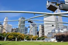Millennium park, Pritzker Pavilion in Chicago. City buildings and Pritzker Pavilion at Millennium Park in Chicago.  Photo taken in October 5th, 2014 Stock Photos