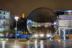 Millennium Square, Bristol. A night-shot of the mirror globe at Bristol's Millennium Square, with Cabot Tower visible in the background Stock Images