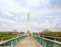 Miller`s bridge cycle and pedestrian bridge over the River Exe i. N Exeter Devon. Also known as the Millennium footbridge Royalty Free Stock Photo