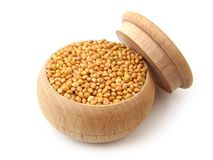 Millet. In wooden pot over white Royalty Free Stock Photos