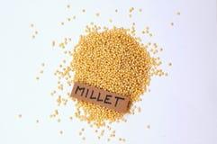 Millet avec le label sur le fond blanc Image stock