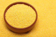 Millet in bowl Royalty Free Stock Image