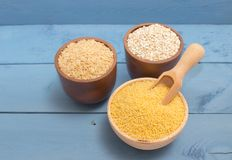 Millet and buckwheat groats, rice on the blue board Royalty Free Stock Photography