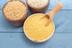Millet and buckwheat groats, rice on the blue board Royalty Free Stock Photo