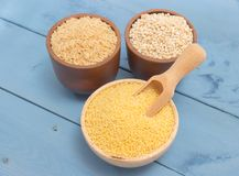 Millet and buckwheat groats, rice on the blue board Royalty Free Stock Image