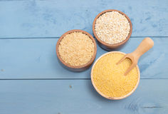 Millet and buckwheat groats, rice on the blue board Royalty Free Stock Photos