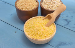 Millet and buckwheat groats, rice on the blue board Stock Photos