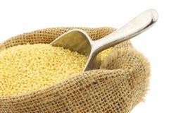 Millet in a burlap bag Stock Photo