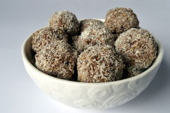 Millet cookies. Homemadecookies -millet flake balls in grated coconut in white bowl Royalty Free Stock Images