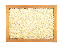 Millet flakes in frame Stock Photos