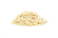 Millet flakes on white Stock Image