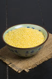 Millet grain. In bowl color on fabric stock images