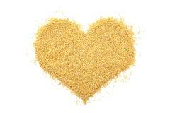 Millet grain in a heart shape Stock Photo