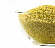 Millet grains. In a bowl. Isolated Royalty Free Stock Images