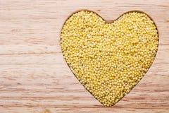 Millet groats heart shaped Royalty Free Stock Photo