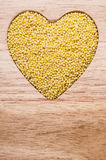 Millet groats heart shaped Royalty Free Stock Image