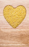 Millet groats heart shaped Royalty Free Stock Images