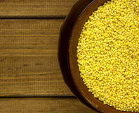 Millet groats in a round pot. Tasty and healthy Stock Photography