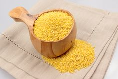 Millet groats in wooden mug Stock Photography
