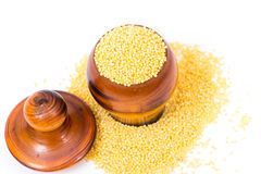 Millet groats in wooden mug Royalty Free Stock Photography