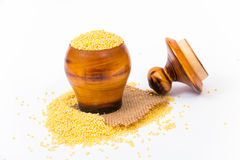 Millet groats in wooden mug Royalty Free Stock Photo