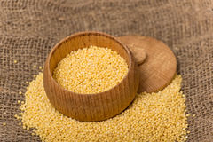 Millet groats in wooden pot Stock Image