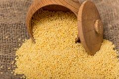 Millet groats in wooden pot Stock Photos