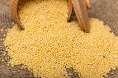 Millet groats in wooden pot Royalty Free Stock Image