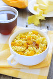 Millet gruel with pumpkin and chestnut honey. Millet gruel with pumpkin and honey Stock Photos