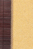 Millet lying on dark bamboo mat, for menu Stock Images