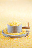 Millet and millstone. , the concept of food Royalty Free Stock Photography