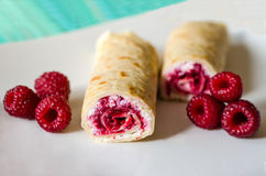 Millet pancakes with raspberry. Pancakes with white cheese and raspberry made from millet flour Stock Images