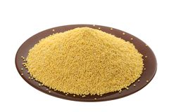 Millet in a plate. On a white background royalty free stock photos