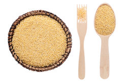 Millet in a plate, fork and spoon Stock Photography
