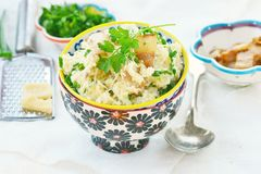 Millet porridge with  bacon and cheese. Royalty Free Stock Image