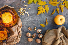 Millet porridge baked in pumpkin, walnut, seeds, apple, yellow leaves, warm sweater Royalty Free Stock Images