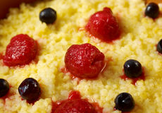 Millet porridge with berry Stock Photos