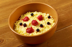 Millet porridge with berry Royalty Free Stock Images